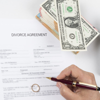 Towson divorce lawyers provide counsel on who is responsible for paying off the debt in a divorce.